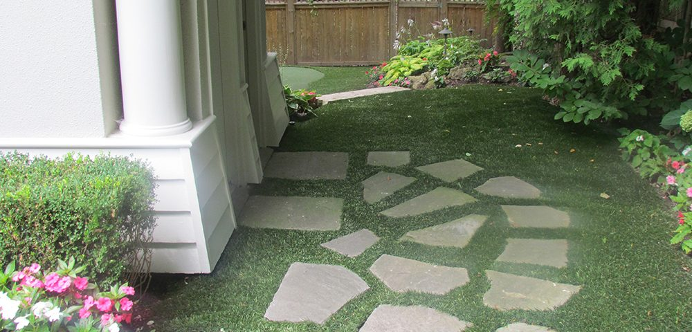 fake grass side yard with flagstone in oakville