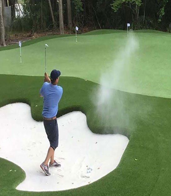 Golfer enjoying local golf green
