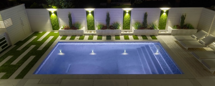Artificial grass landscaping by a pool