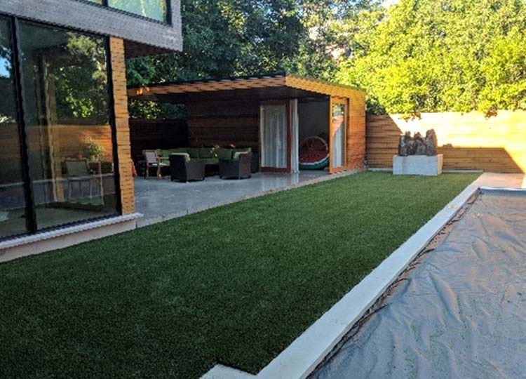 Stylish backyard with artificial grass