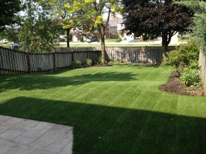 Large rolling yard makes for a lot of mowing. No more with artificial grass