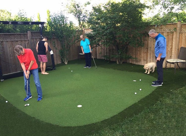 Playing golf on artificial backyard golf green
