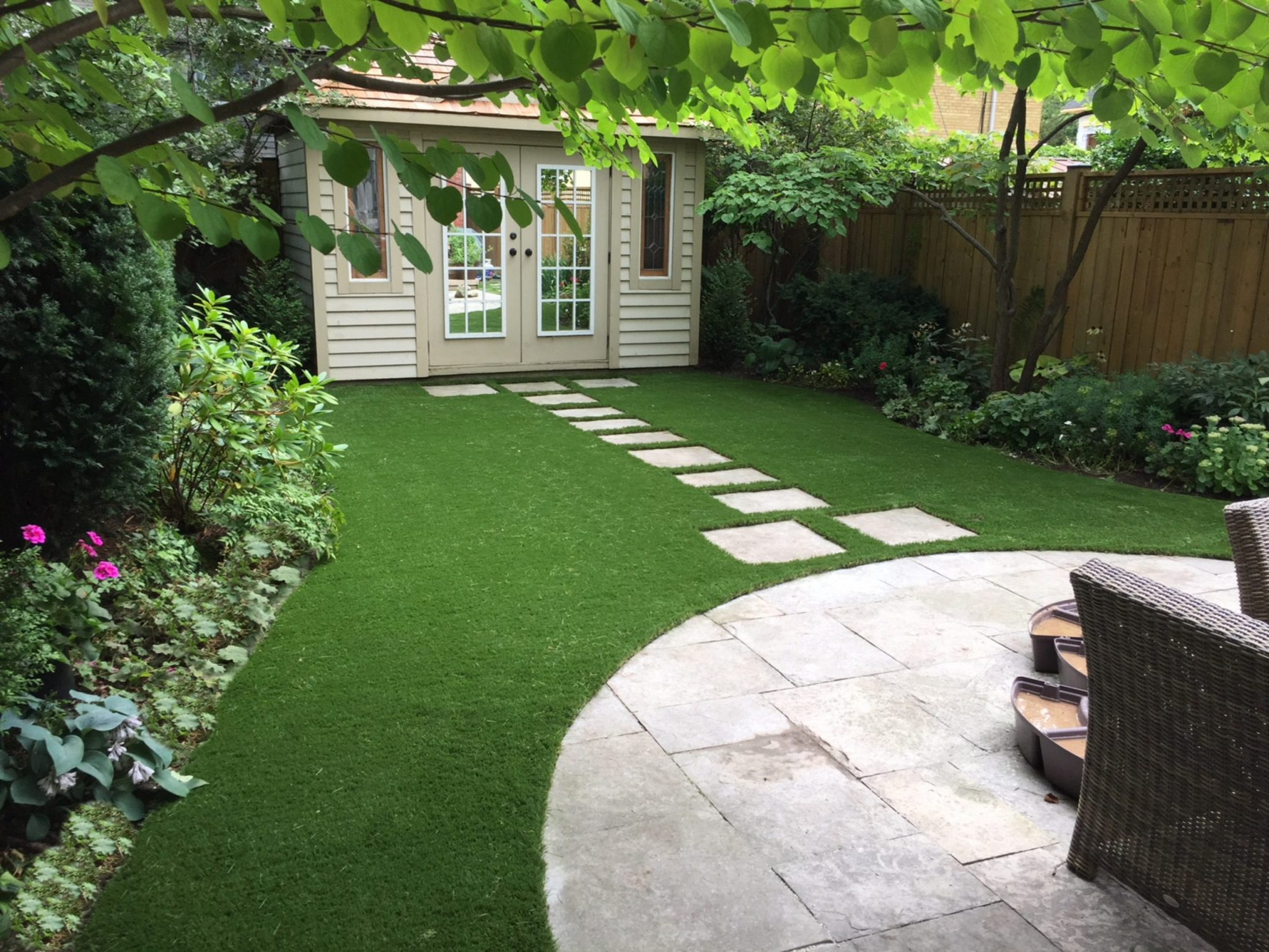 Flagstone path adds natural look around artificial grass