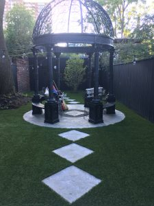 Modern Gazebo sitting area with plush landscape grass