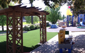 Oshawa daycare with artificial grass providing clean soft surface for kids playing