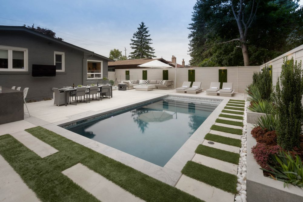 Beautiful Swimming pool with artificial grass softening the look