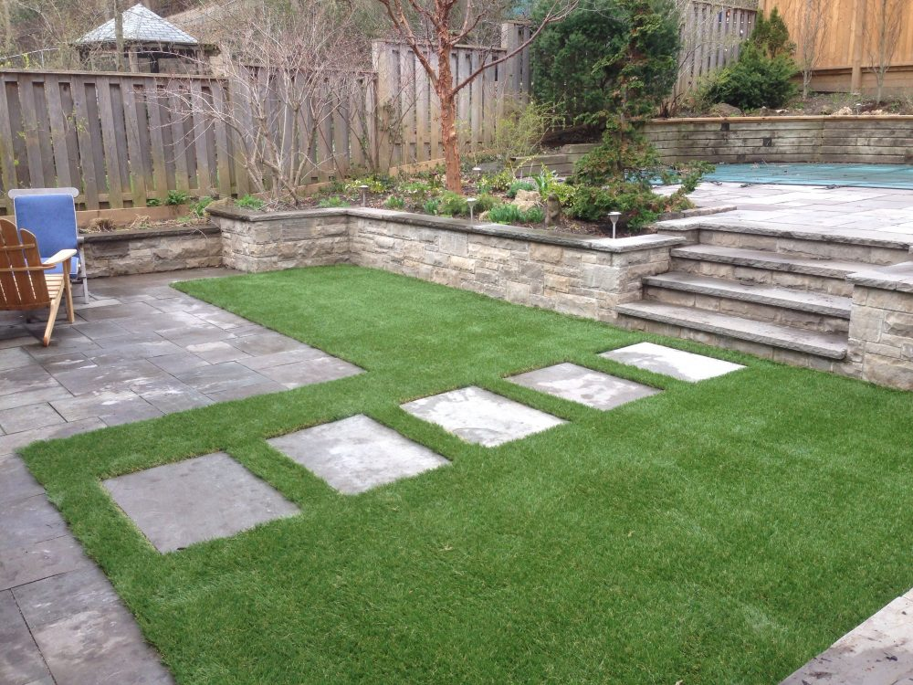 Pathway in artificial grass to upper deck
