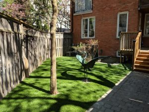 minimalist yard with artificial grass with focus on art