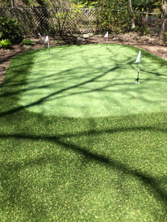 Golf green tucked into well garden landscaping
