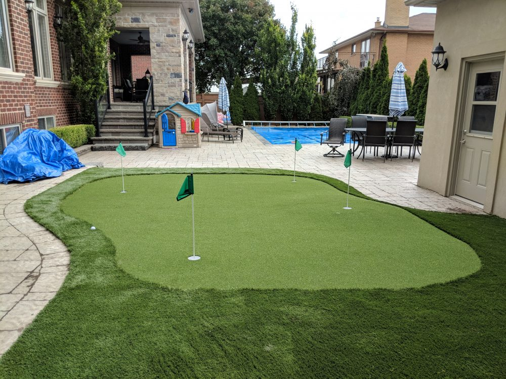 Synthetic 4- hole green compilments this active backyard