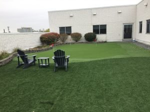 Rooftop large golf green and landscape grass in Toronto