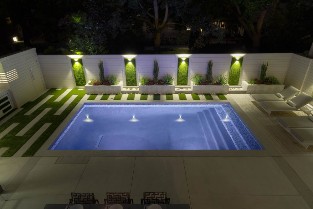 artificial grass walls lit with night lighting