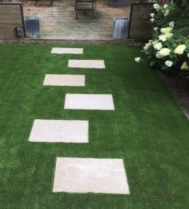 Nicely placed pavers throughout the synthetic turf
