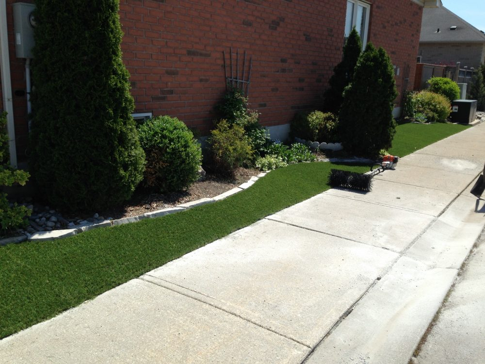 Artificial grass alongside sidewalks