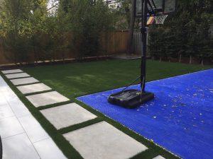 Flagstone path basket ball court artificial grass