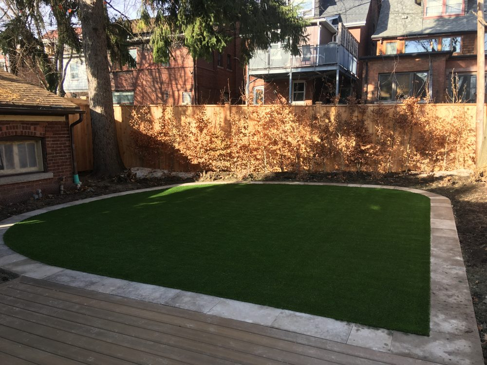 artificial grass framed with flagstone