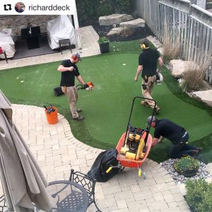Finishing touches on a very sweet artificial golf green