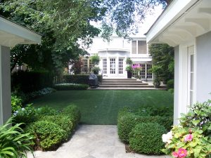 immaculate backyard with formal gardens