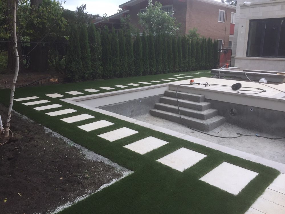 Artificial grass makes this Toronto backyard immaculate to match landscape