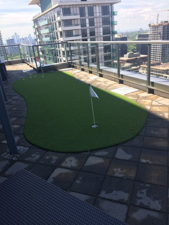 2-hole artificial golf green on balcony.-
