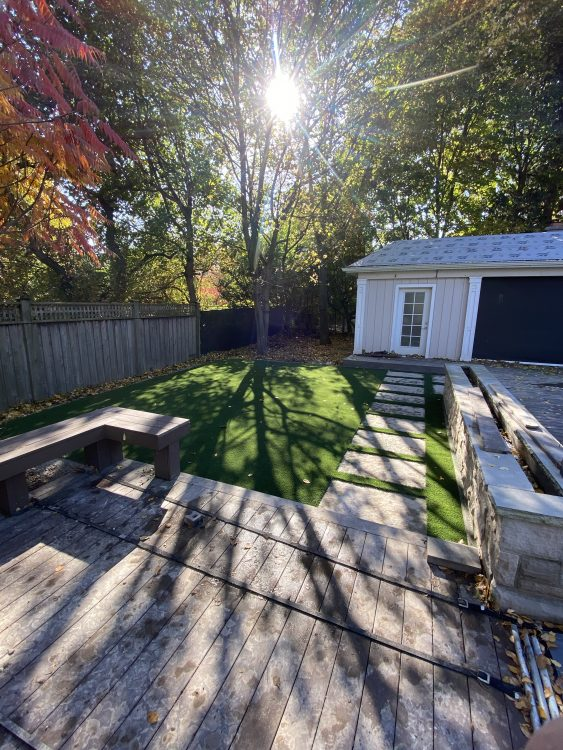 Cedar deck paver path bordered with grass