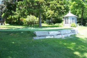 green with large Armour rock retaining stones