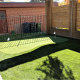2 hole with iron fencing with complimentary landscape grass