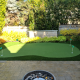 Kidney shaped 4 hole synthetic golf green