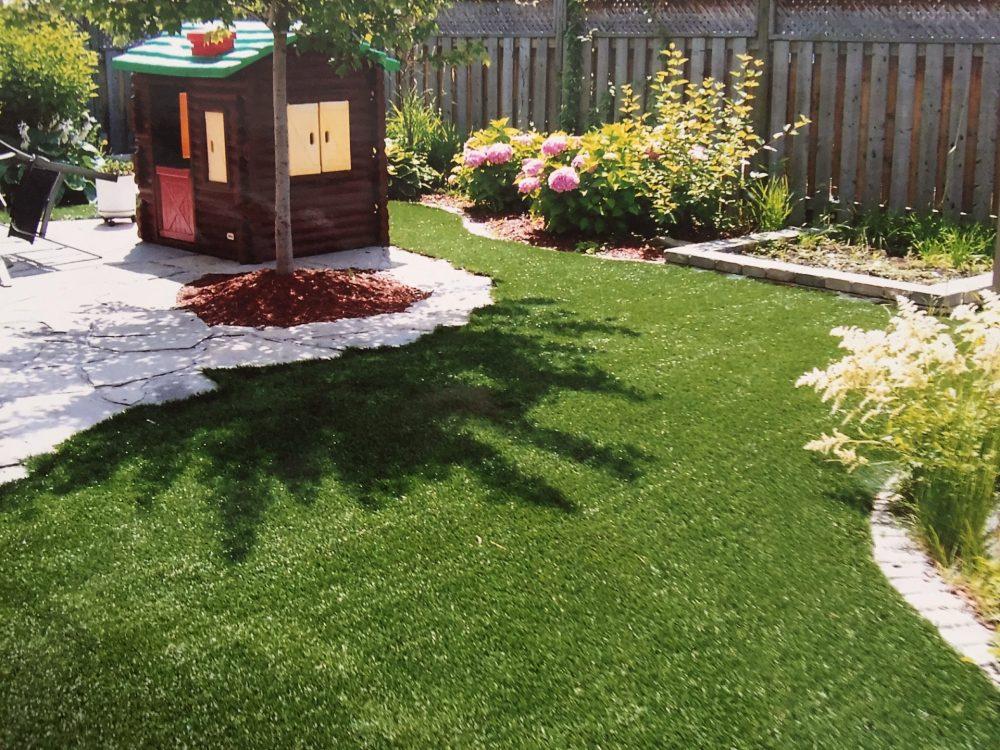 professional cutting the turf around flagstones